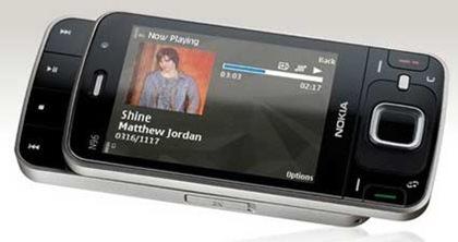 Celular Nokia n96 semi aberto, tocando vídeo